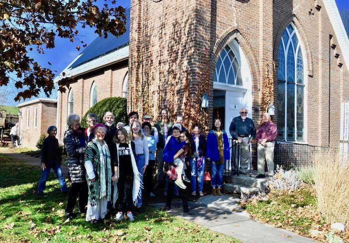 Members and attenders at Valley Friends Meeting celebrate the installation of solar panels on the Meeting House. December 2018.